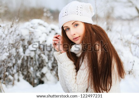 Portrait of attractive young brunette in winter