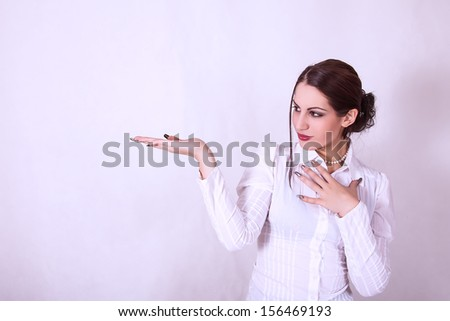 portrait of attractive young business woman showing something on a palm