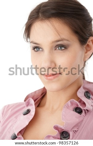 Portrait of attractive young businesswoman, smiling, wearing pink blouse.
