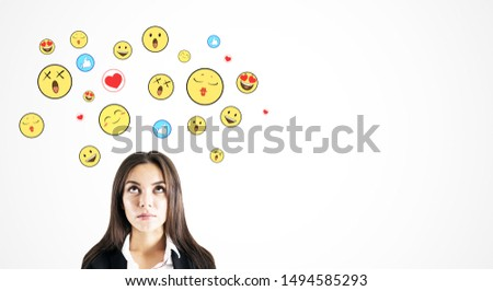 Portrait of attractive young businesswoman with emotive on subtle white background. Communication and emotion concept