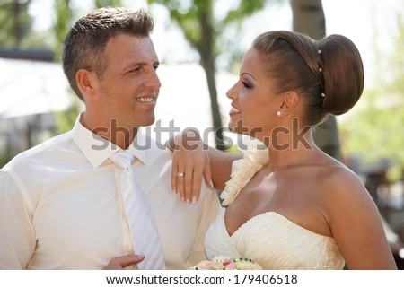 Portrait of attractive young couple on wedding-day, smiling.