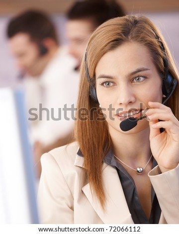 Portrait of attractive young female dispatcher smiling in call center.?