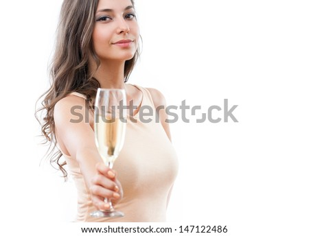 Portrait of attractive young festive brunette offering a glass of champagne.