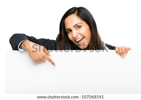 Portrait of attractive young indian woman holding billboard on white background