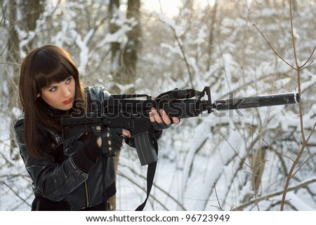 Portrait of attractive young lady with a rifle