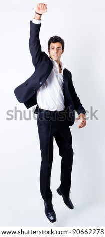 Portrait of attractive young man jumping