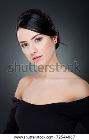 Portrait of attractive young smiling woman with beautiful face