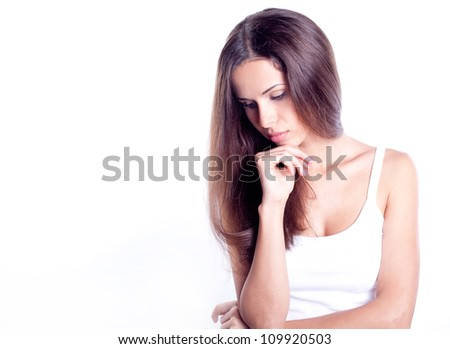 Portrait of attractive young woman against white background