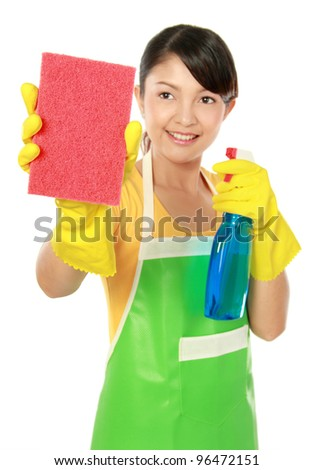portrait of Attractive young woman cleaning something isolated on white background