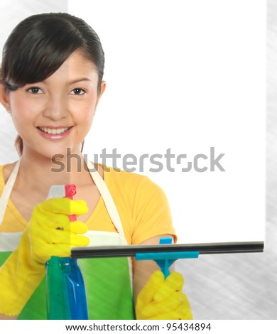 portrait of Attractive young woman cleaning windows. copy space for your text