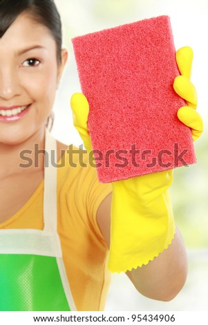 portrait of Attractive young woman cleaning windows isolated over white background