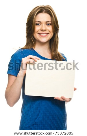 Portrait of attractive young woman holding blank billboard against white background