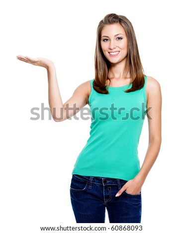 Portrait of attractive young woman showing something on palm - isolated