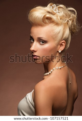 Portrait of attractive young woman with beautiful make-up and hairstyle