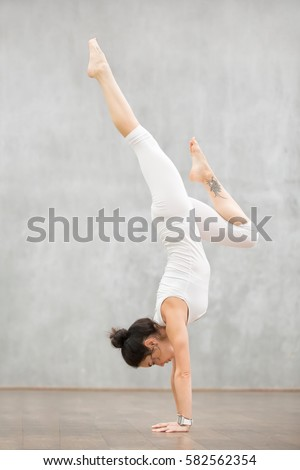 Free Photos Woman Athlete Doing A Handstand Against The Wall In The