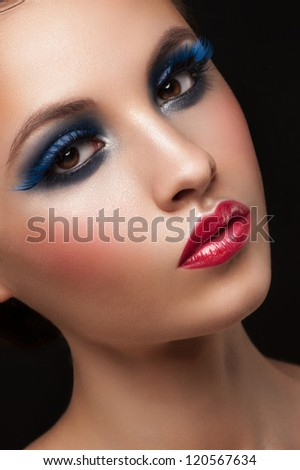 Portrait of attractive young woman with bright creative makeup