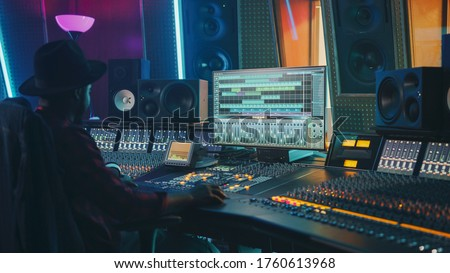 Portrait of Audio Engineer Working in Music Recording Studio, Uses Mixing Board Create Modern Sound. Successful Black Artist Musician Working at Control Desk. Foto d'archivio ©