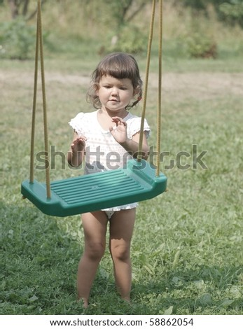 Portrait of baby by the swing