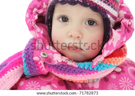portrait of baby girl in winter wear