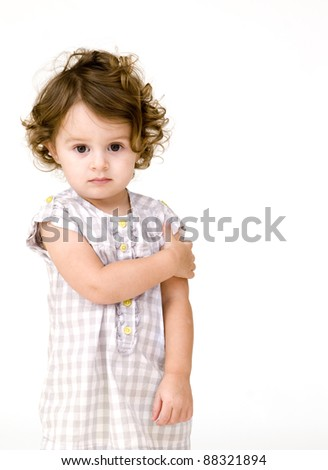 portrait of baby girl on a white background
