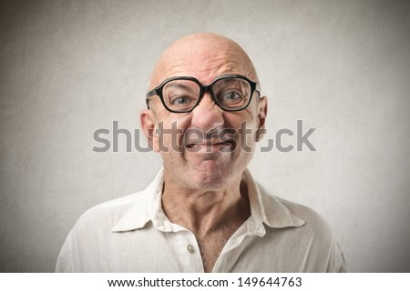 portrait of bald man making grimace