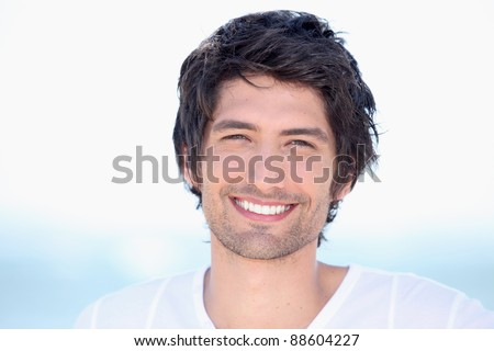 portrait of beaming young man