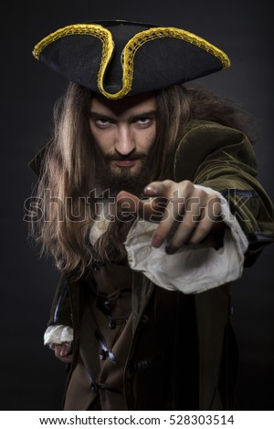 portrait of bearded and hairy pirate pointing into the viewer, shallow DOF #528303514
