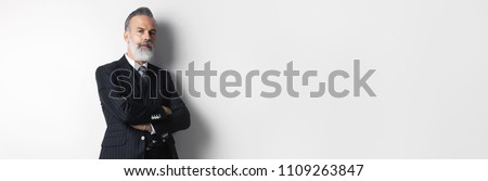Portrait of bearded attractive gentleman wearing trendy suit over empty white background. Copy Paste text space. Wide