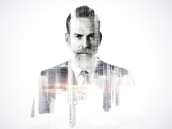 Portrait of bearded businessman. Double exposure city on the background. Black and white