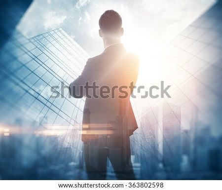 Portrait of bearded gentleman in suit. Double exposure skyscraper on the background. Visual effects.
