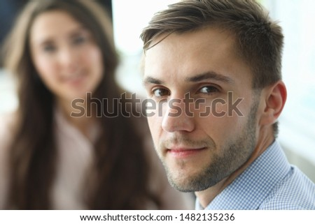 Portrait of bearded male worker sitting in company office and looking at camera with calmness. Smiling man discussing important business agreement. Biz meeting concept. Blurred background #1482135236