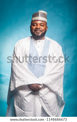 Portrait of bearded Man in Traditional Nigerian Attire and Hat