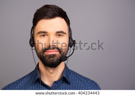 Portrait of bearded young worker of call center