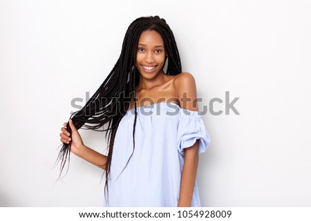 Portrait of beautiful african american woman with braided hair smiling against white background