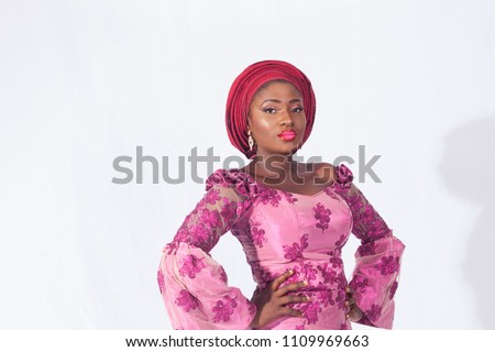 Portrait of beautiful African woman in purple traditional attire