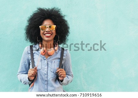 Portrait of beautiful afro american woman in the street.