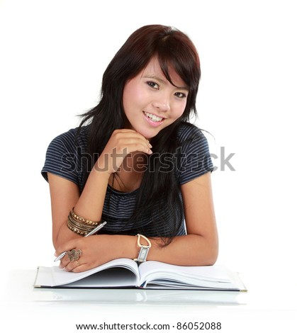 portrait of beautiful asian girl reading book