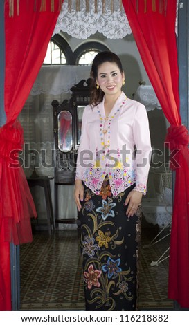 portrait of beautiful asian woman smiling with traditional clothing Peranakan dress
