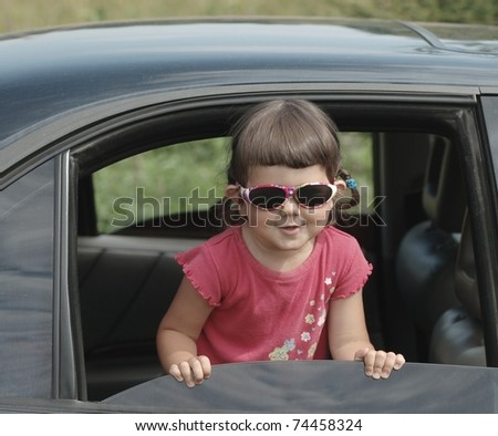 Portrait of beautiful baby in car