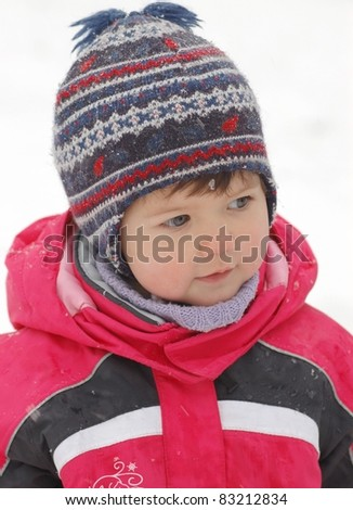 Portrait of beautiful baby in winter time