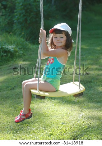 Portrait of beautiful baby on the swing