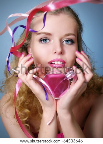 Portrait of beautiful blond and sexy woman with perfume