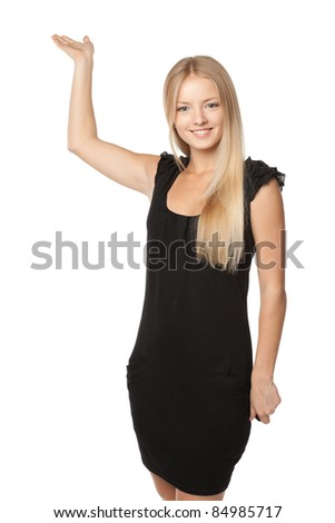 Portrait of beautiful blond business woman in black dress showing copy space placed upwards over white background