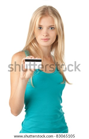 Portrait of beautiful blond female holding credit card over white background