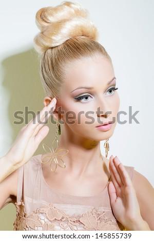Portrait of beautiful blond girl looking like doll Stock photo ©