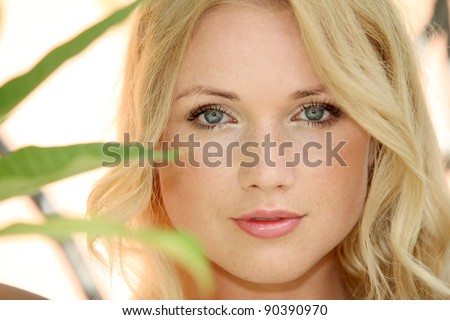 Portrait of beautiful blond woman in nature