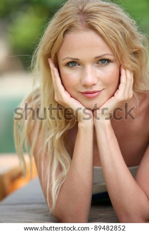 Portrait of beautiful blond woman relaxing in garden