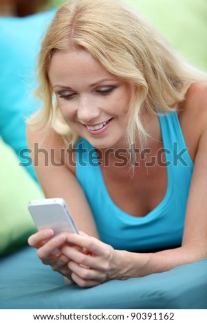 Portrait of beautiful blond woman using cellphone