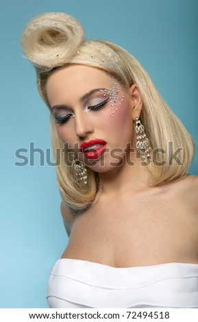 Portrait of beautiful blond woman with fashion make up and hairstyle, eyes closed