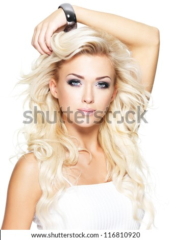 Portrait of beautiful blond woman with long curly hair - isolated on white